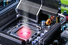 Abstract hardware concept. Burning CPU socket surrounded with radiators Stock Photography