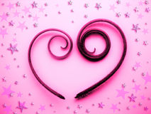 Abstract heart design. Spiral Heart with stars Stock Photo