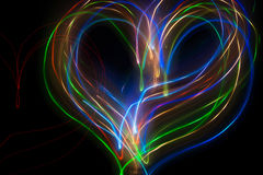 Abstract heart drawing with light. Abstract heart colored drawing with light Royalty Free Stock Images