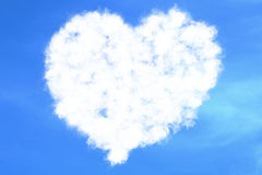 Abstract heart filled love concept draw on the blue sky with white clouds background with alpha channel matte, valentine day holid. Ay event festive symbol sign Royalty Free Stock Photo