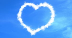 Abstract heart love concept draw on the blue sky with white clouds background with alpha channel matte, valentine day holiday stock video footage