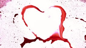 Heart shape from splashes and blobs. Abstract heart shape from splashes and blobs stock video