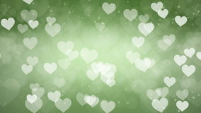 Abstract Hearts Bokeh Green Background. stock video footage