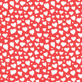 Abstract Hearts Seamless Pattern Doodle Texture. Abstract doodle hearts seamless pattern texture. Various size hand drawn white hearts on red background Royalty Free Stock Photography