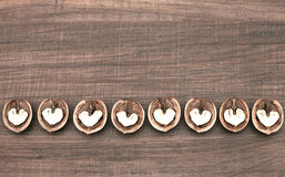 Abstract hearts in walnuts Royalty Free Stock Image