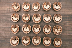 Abstract hearts in walnuts on wooden background Stock Image