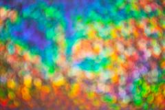 Abstract heavily blurred rainbow background with numerous colourful bright festive bokeh. Texture with copy space for text. Celebration, holidays concept royalty free stock photography
