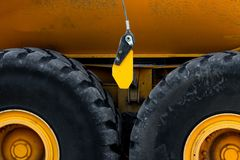 Abstract of heavy duty truck wheels. And a yellow body stock image