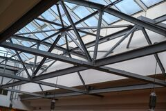 Free Abstract High-tech Architecture. Modern Metal Building Structures. Glass Roof From The Inside Royalty Free Stock Images - 170554409