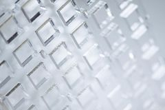 Abstract high-tech background. A sheet of transparent plastic or glass with the cut out holes. Laser cutting of. Abstract high-tech geometrical background. A Royalty Free Stock Photo