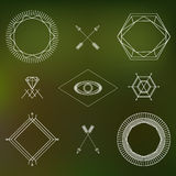Abstract hipster outline symbols and badges set on blurred background Royalty Free Stock Photo