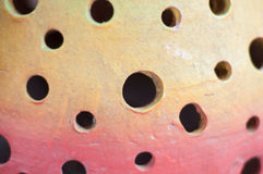 Abstract hole background. From ceramic lamb Royalty Free Stock Image