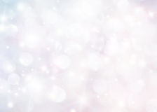 Abstract holiday background. Beautiful shiny christmas lights and winter snowflakes, glowing magic bokeh royalty free stock image