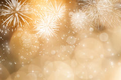 Abstract holiday background with fireworks and sparkling lights Royalty Free Stock Image