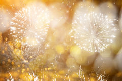 Abstract holiday background with fireworks and stars Stock Photo
