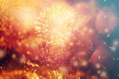 Abstract holiday background with fireworks and stars Stock Photos