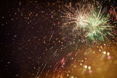 Abstract holiday background, glitter lights and firework overlay Royalty Free Stock Images