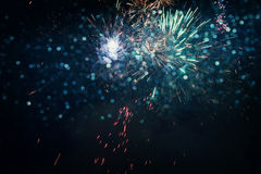 abstract holiday background, glitter lights and firework Stock Photos