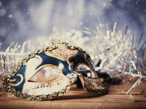 Abstract holiday backgrounds with carnival mask. Christmas night, abstract holiday backgrounds with carnival mask over wooden desk Royalty Free Stock Photo