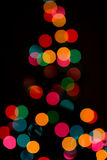 Abstract holiday lights. Focus dialed out to create this abstract shot of a lit christmas tree.  Shot with 85mm F1.2 lens at 1.8 Stock Photo