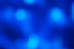 Abstract holiday lights background. In dark blue colors Royalty Free Stock Photography