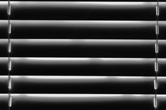 Abstract horizontal stripes in black and white background. Closed venetian blinds black and white background Royalty Free Stock Images