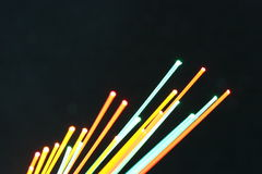 Abstract hot fiber optics. Abstract hot colorful fiber optics on a black background Royalty Free Stock Image
