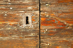abstract  house  door       italy  lombardy   red   closed  nail Royalty Free Stock Images