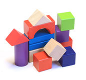 Abstract house made from colorful wooden building blocks. On white background stock photography