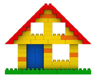 Abstract house from plastic building blocks. 3d render of abstract house from plastic building blocks isolated over white background Stock Image