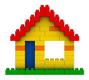 Abstract house from plastic building blocks. 3d render of abstract house from plastic building blocks isolated over white background Stock Photography