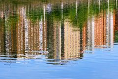 Abstract houses water reflection Stock Images