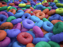 Abstract hyper-colored donuts Stock Photography