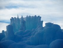 Abstract Ice Sculptures Against A Partially Cloudy Sky stock photography