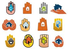 Abstract icons of houses in hands Stock Images