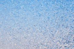Abstract ijzig patroon op glas, achtergrondtextuur stock afbeelding