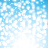 Abstract  illustration. Bokeh effect, glitter and circles on blue background. Blurred Lights Stock Images