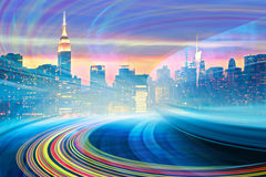 Abstract Illustration of an urban highway going to the modern city downtown. Speed motion with colorful light trails. Image of New York City skyline is from my stock illustration
