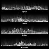 Abstract illustrations of Tokyo, Seoul, Sydney and Auckland skylines at night in grey scales. Stock Image