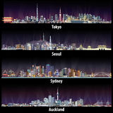 Abstract illustrations of Tokyo, Seoul, Sydney and Auckland skylines at night. Royalty Free Stock Images