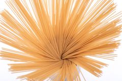 Abstract image from above of an Organic uncooked Brown Rice Spaghetti pasta arranged in a ceramic tall jar. Gluten-free and sodium-free alternative to royalty free stock photo