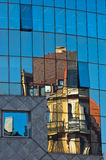 Abstract image as a reflection of old style buildings in a glass of super modern building at downtown of Vienna. Austria Royalty Free Stock Image
