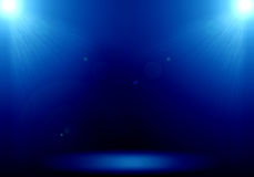 Abstract image of blue lighting flare 2 spotlight on the floor s. Tage royalty free illustration