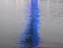 Abstract image of blue lighting reflecting off of water Stock Image