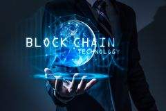 The abstract image of the business man hold the blockchain hologram on hand and element of this image furnished by Nasa. royalty free stock image