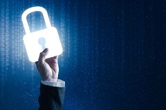 The abstract image of the businessman hold the padlock hologram on hand. stock photo