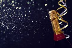 Abstract image of champagne bottle and festive lights Stock Images
