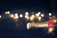 Abstract image of champagne bottle and festive lights Royalty Free Stock Image