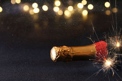 Abstract image of champagne bottle and festive lights Stock Photos