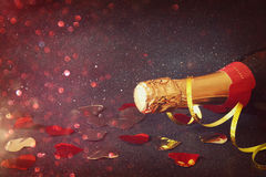 Abstract image of champagne bottle and festive lights Royalty Free Stock Images
